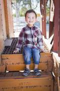 Cute Young Mixed Race Boy Having Fun Outside Sitting on Railroad Car Steps. Stock Photos