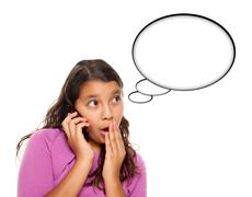 Shocked Hispanic Teen Aged Girl on Phone with Blank Thought Bubble Stock Photos