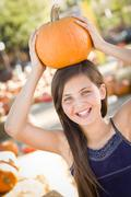 Preteen Girl Portrait at the Pumpkin Patch in a Rustic Setting. Stock Photos