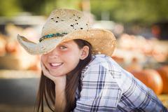 Preteen Girl Portrait at the Pumpkin Patch - stock photo