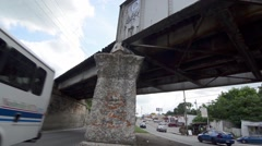 Tilted Shot of Two Way Traffic Under a Bridge With Graffiti on it Stock Footage