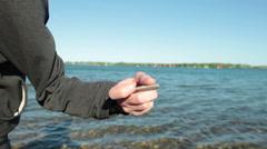 Man Skipping Stone In Lake 2 Stock Footage