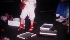 2210 - little girl gets high heels & purse on Christmas -vintage film home movie Stock Footage