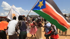 WAVING THE SOUTH SUDAN FLAT AT POLITICAL RALLY IN SOUTH SUDAN, AFRICA Stock Footage