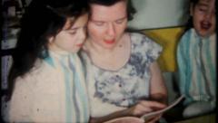 2213 - homework after school with moms help - vintage film home movie Stock Footage