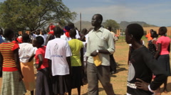 MEN JUMP TOGETHER AT POLITICAL RALLY IN SOUTH SUDAN, AFRICA Stock Footage