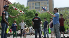 performers Washington Square Park juggling people 4K slow motion NYC - stock footage