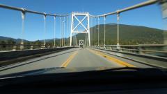 Driving Across suspension bridge in Revelstoke, British Columbia POV Stock Footage