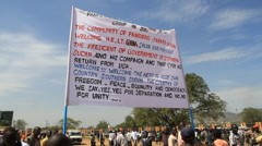PROTESTE SIGN AT POLITICAL RALLY IN SOUTH SUDAN, AFRICA Stock Footage
