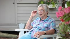 Senior Citizen Woman Sitting on Deck Chatting - stock footage