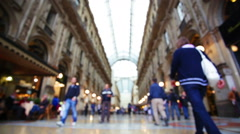 Crowd shopping at indoor mall in Milan blurred background Stock Footage