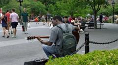 black guitar player, man plays guitar slow motion 4K Washington Square Park NYC - stock footage