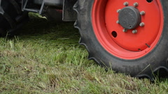 Special tractor equipment collect gather hay in field Stock Footage