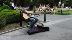 Black man playing guitar Washington Square Park 4K NYC Stock Footage