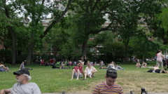 New Yorkers tourists people relaxing bench 4K Washington Square Park NYC Stock Footage