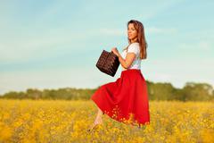 Girl walks on a meadow. - stock photo