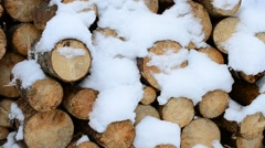 Beautiful white snow falling gently on background of wooden logs Stock Footage