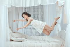 Levitation over the bed. - stock photo