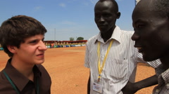 Stock Video Footage of MEN TALK TO REPORTER AT POLITICAL RALLY IN SOUTH SUDAN, AFRICA