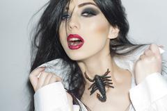 Tempting girl with scorpion Stock Photos