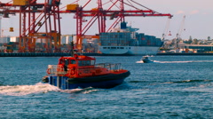 Pilot Boat Coming Into Port With Docks In The Background Stock Footage