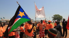 Protesters Waving Flag of SOUTH SUDAN, AFRICA Stock Footage