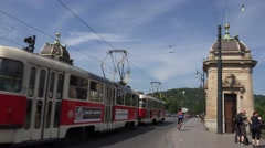 ULTRA HD 4K Busy traffic car old bridge tramway stop light Prague city people  Stock Footage