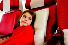 Little girl in a plane scared to fly -  flying phobia Stock Photos