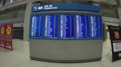 Airport flight information on a large screen international departure board. Stock Footage