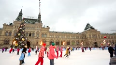 Many young people skate on the Red square ice rink. - stock footage