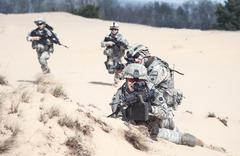 infantrymen in action - stock photo