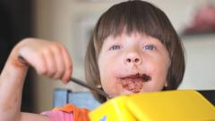 Stock Video Footage of Smeared Girl with Chocolate cacao Little Girl eating Cacao 02