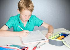 Child practicing English for an English work at school Stock Photos