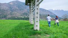 Walking pass traditional hayrack Stock Footage