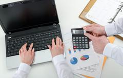 Businessteam working on financial results - stock photo