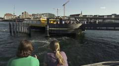 Still 2 persons and Copenhagen harbour bus Stock Footage