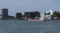 Short sea vessel passing the Maastunnel ventilation building  Stock Footage
