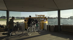 Quick pan bikes getting onboard harbour bus Stock Footage