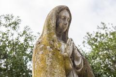 Virgin Mary Stone statue in a garden Stock Photos