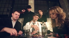Gang of gangsters playing poker. - stock footage