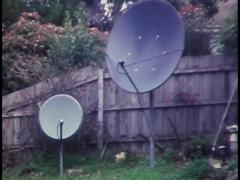 SATELLITE TV/ PAY TV DISHES KU BAND (archive footage)  Stock Footage