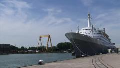 The fifth SS Rotterdam, also known as The Grande Dame, moored Stock Footage
