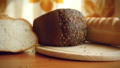 Slowmotion of Variety of bread on the table in kitchen Stock Footage