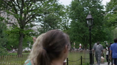 People Walking in Washington Square Park in slow motion tourism tourists 4K NYC Stock Footage