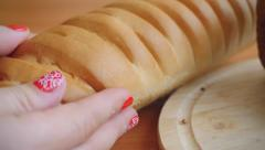 Variety of bread on the table in kitchen and woman hands put French Bread Stock Footage