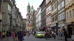 ULTRA HD 4K Narrow street pedestrian people old town Prague church shopping icon Stock Footage