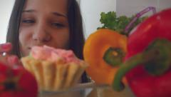 Young woman stops her diet and look for a cake in the refrigerator, but takes Stock Footage