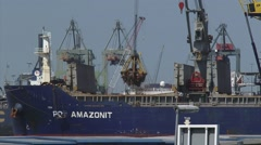 Stock Video Footage of Loading bulk carrier Amazonit with scrap metal + zoom out Waalhaven Rotterdam