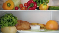 Stopmotion from the start of filled refrigerator with useful products Stock Footage