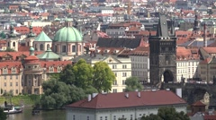 ULTRA HD 4K Aerial view Charles bridge red rooftop Prague landmark famous city  Stock Footage